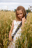 Menina com clarinete Foto de Stock Royalty Free