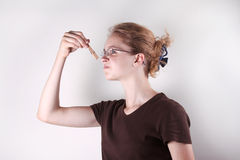 Menina com Clothespin Fotos de Stock