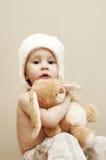 Menina com coelho enchido Imagem de Stock