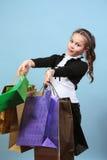 Menina com compras. Fotos de Stock