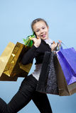 Menina com compras. Imagens de Stock Royalty Free