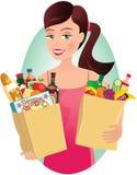 Menina com compras na mercearia Foto de Stock