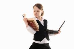 Menina com computador e livro no fundo branco Fotos de Stock Royalty Free