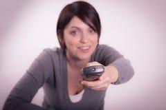 Menina com controlo a distância Imagens de Stock