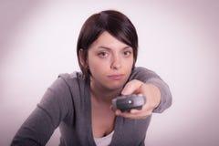 Menina com controlo a distância Fotos de Stock