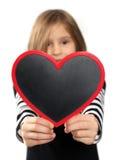 Menina com coração Imagem de Stock