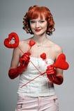 A menina com corações fotos de stock royalty free