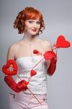 A menina com corações foto de stock royalty free