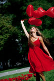 Menina com corações Fotos de Stock Royalty Free