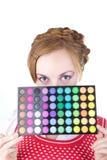 Menina com cosméticos Imagem de Stock