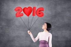 Menina com data 2016 Fotos de Stock Royalty Free