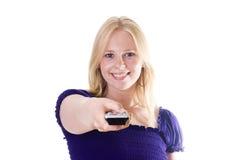 Menina com de controle remoto Imagem de Stock Royalty Free
