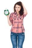 Menina com despertador Foto de Stock