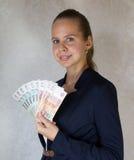 Menina com dinheiro à disposição Fotografia de Stock