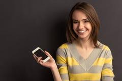 Menina com dispositivo Fotos de Stock Royalty Free