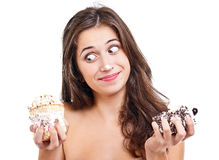 Menina com dois bolos Imagens de Stock Royalty Free