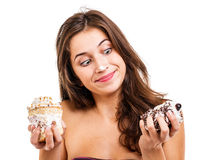 Menina com dois bolos Imagem de Stock Royalty Free