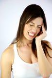 Menina com dor de cabeça forte Foto de Stock Royalty Free