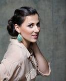 Menina com earing Imagens de Stock Royalty Free