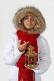 Menina com a esfera e a lâmpada do Natal Imagens de Stock Royalty Free