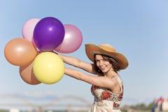 A menina com esferas Foto de Stock Royalty Free