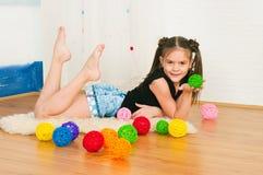 Menina com esferas multi-colored Fotos de Stock