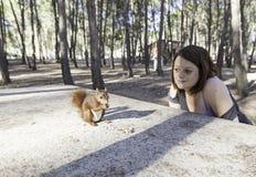 Menina com esquilo Fotos de Stock