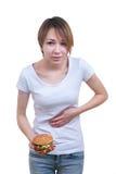 Menina com estômago-dor forte Imagem de Stock Royalty Free