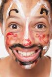 Menina com face pintada Fotografia de Stock