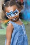 Menina com face pintada Imagem de Stock