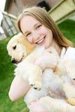 Menina com filhote de cachorro Foto de Stock Royalty Free