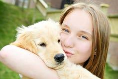Menina com filhote de cachorro Imagem de Stock Royalty Free