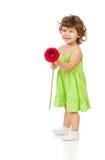 Menina com a flor da margarida africana Fotografia de Stock Royalty Free