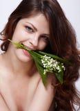 Menina com flores Imagens de Stock