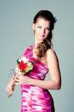 A menina com flores foto de stock royalty free