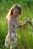 Menina com flores Fotografia de Stock