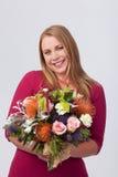 Menina com flores Fotos de Stock