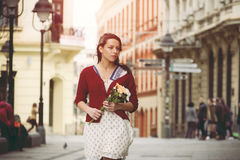Menina com flores Foto de Stock Royalty Free