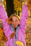 Menina com folhas Fotografia de Stock Royalty Free