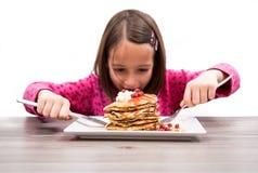 Menina com fome Fotografia de Stock