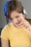 Menina com fone de ouvido fotos de stock