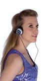 Menina com fones de ouvido foto de stock royalty free