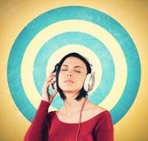 Menina com fones de ouvido Imagem de Stock
