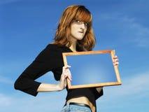 Menina com frame Fotos de Stock Royalty Free