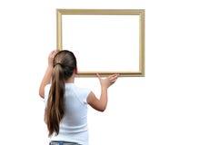 Menina com frame de retrato fotos de stock