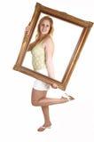 Menina com frame de retrato. foto de stock royalty free