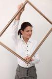 Menina com frame de retrato Fotografia de Stock