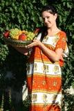 A menina com fruta Imagens de Stock