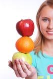 A menina com fruta Foto de Stock