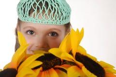 Menina com girassóis Fotos de Stock Royalty Free